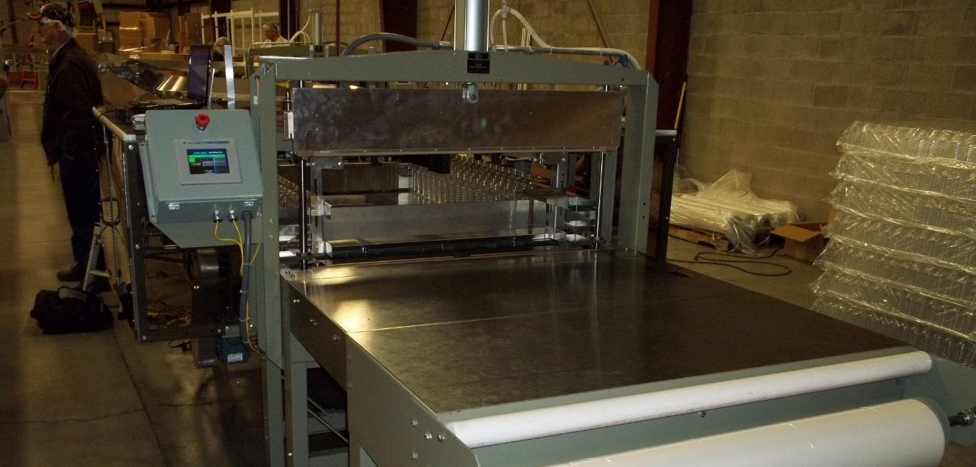 Custom Metal Designs Semi-Bagger reduces labor costs and increases productivity