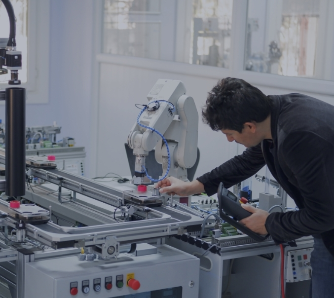 man collaborating with robot